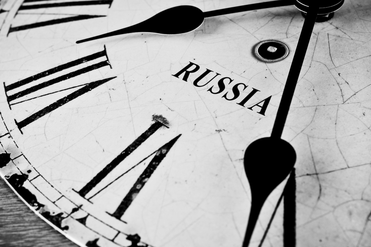 A cracked and weathered black and white close face depicting the time in Russia
